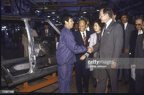 Vice President George Bush touring a Jeep plant