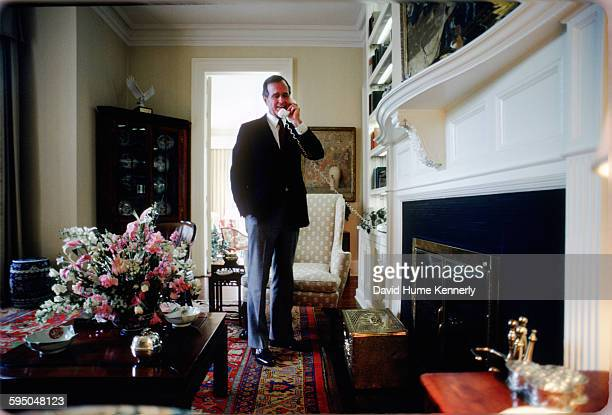 Vice President George HW Bush answers a phone call in the Vice President's Residence circa 1983 in Washington DC