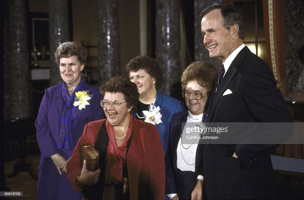 Vice President George H.W. Bush (R), re-enacting Senate Swear- In with Sen. <a gi-track='captionPersonalityLinkClicked' href=/galleries/search?phrase=Barbara+Mikulski&family=editorial&specificpeople=226768 ng-click='$event.stopPropagation()'>Barbara Mikulski</a> (C) with friends and family.