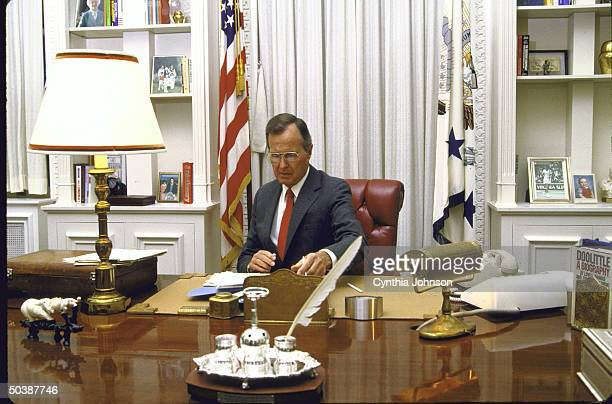 Vice President George HW Bush working in his office at the White House