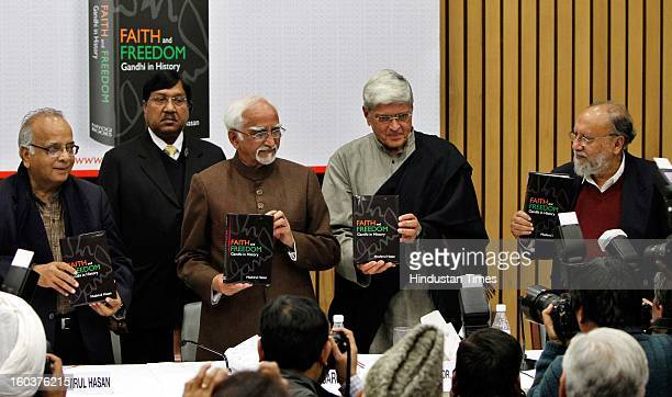Vice President Hamid Ansari alongwith Gopal Krishna Gandhi Renowned Sociologist Ashis Nandy and Author Mushirul Hasan release the book 'Faith and...