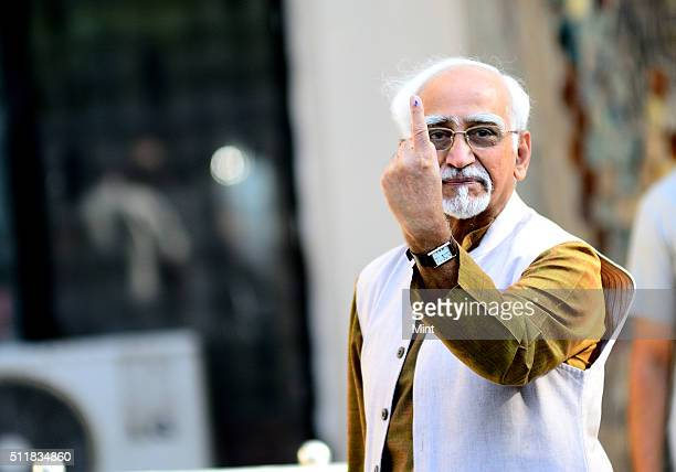 Vice President Hamid Ansari shows his inkmarked finger after casting his vote for general election of the 16th Lok Sabha 2014 on April 10 2014 in New...