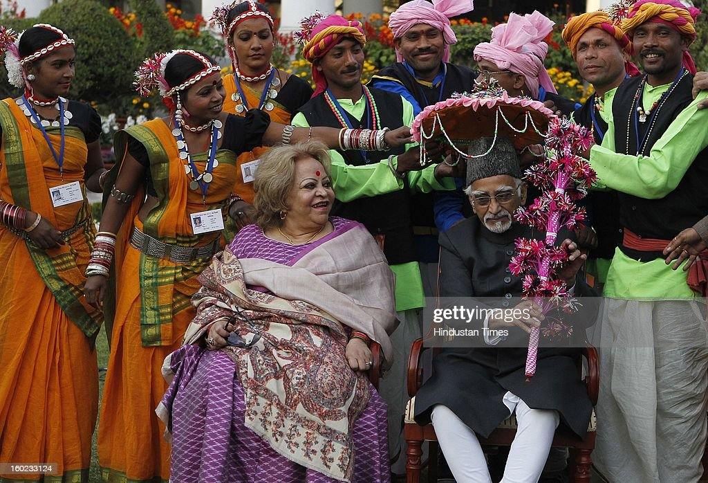 Vice President Hamid Ansari with his wife Salma Ansari and artists who participated in the Republic Day Parade-2013, at Vice President House on January 28, 2013 in New Delhi, India.