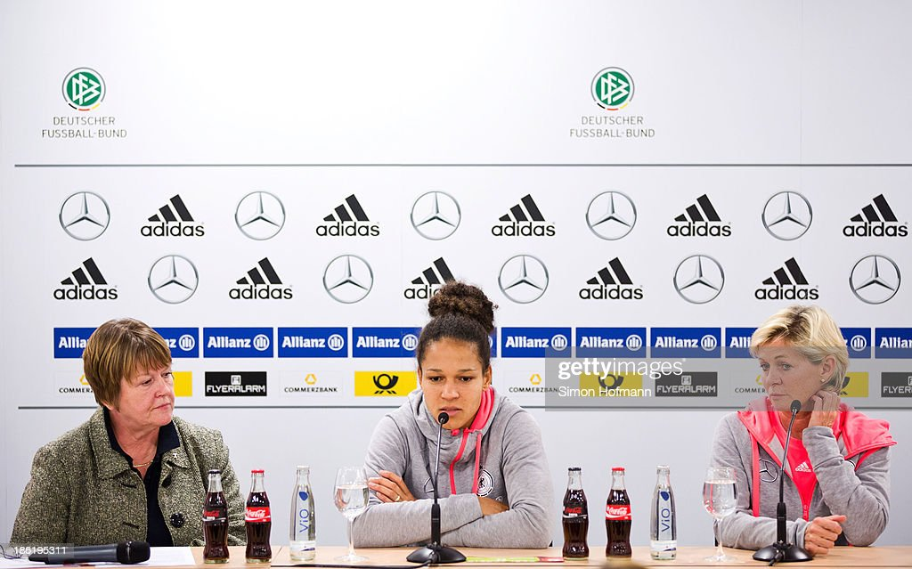 Vice President Hannelore Ratzeburg, Celia Sasic and head coach Silvia Neid (L-R) attend a Germany women's press conference at Volksbank Stadion on October 29, 2013 in Frankfurt am Main, Germany.