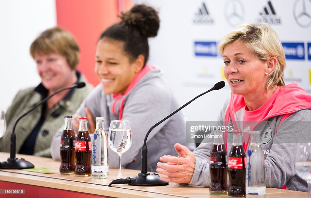 Vice President Hannelore Ratzeburg, Celia Sasic and head coach Silvia Neid (L-R) smile during a Germany women's press conference at Volksbank Stadion on October 29, 2013 in Frankfurt am Main, Germany.