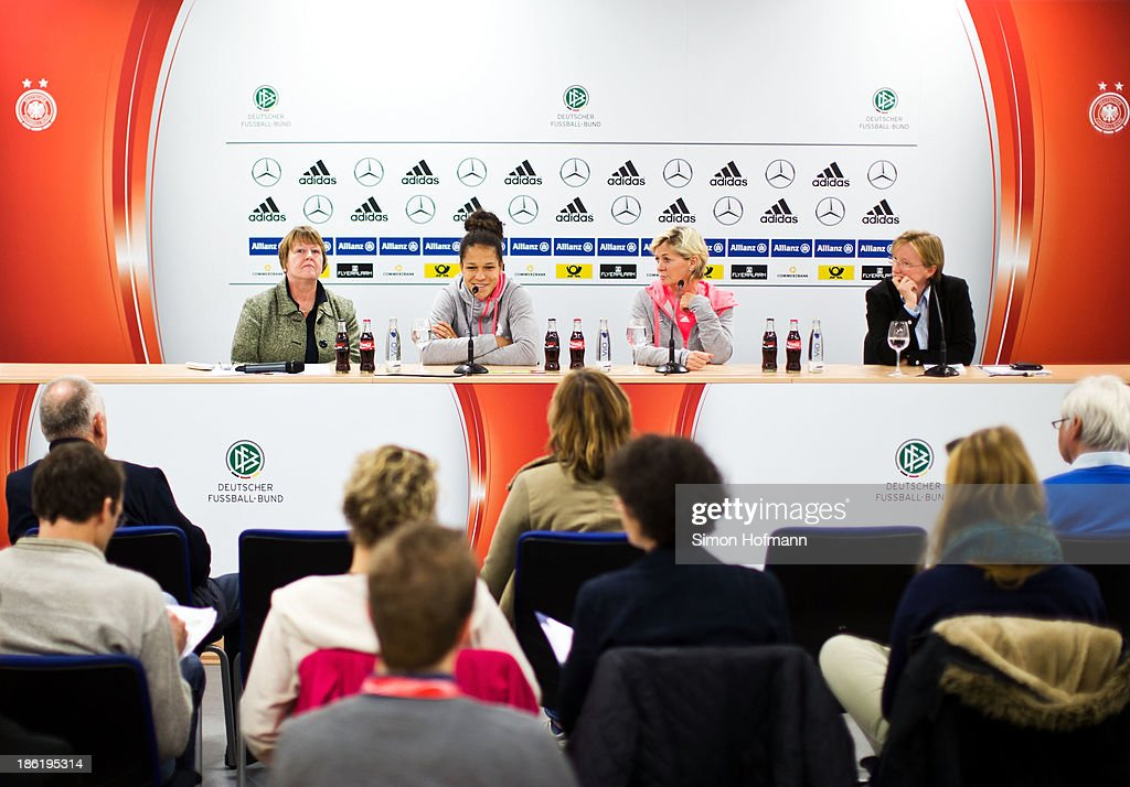 Vice President Hannelore Ratzeburg, Celia Sasic, head coach Silvia Neid and Annette Seitz of the DFB (L-R) attend a Germany women's press conference at Volksbank Stadion on October 29, 2013 in Frankfurt am Main, Germany.