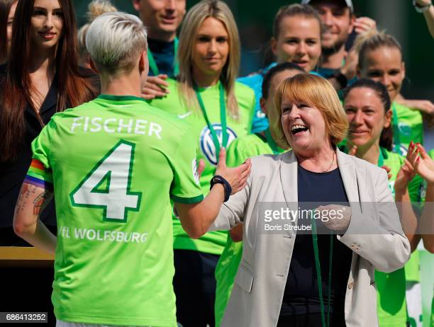 DFB vice president Hannelore Ratzeburg hands the medal over to Nilla Fischer of VfL Wolfsburg in celebration of the German Championship title...