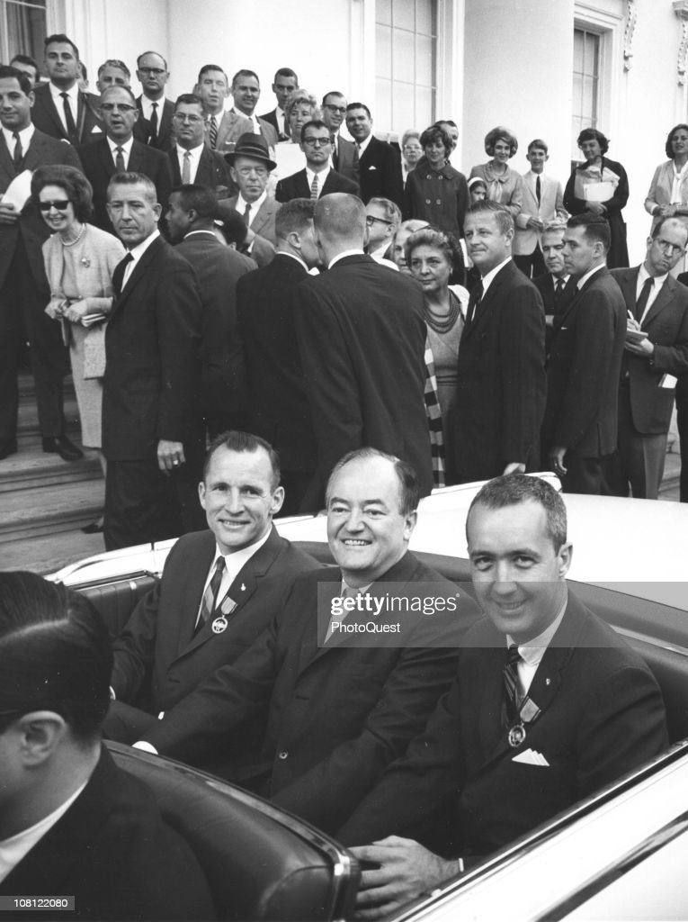 US Vice President <a gi-track='captionPersonalityLinkClicked' href=/galleries/search?phrase=Hubert+Humphrey&family=editorial&specificpeople=91105 ng-click='$event.stopPropagation()'>Hubert Humphrey</a> (1911 - 1978) (center, fore) sits between American astronauts <a gi-track='captionPersonalityLinkClicked' href=/galleries/search?phrase=Ed+White+-+Astronaut&family=editorial&specificpeople=90760 ng-click='$event.stopPropagation()'>Ed White</a> (left) and James A. McDivitt (1930 - 1967) (right) in a convertible outside the White House, Washington DC, June 17, 1965. The astronauts where invitied to the White to receieve citations from President Lyndon Johnson after the completion of the Gemini IV mission.