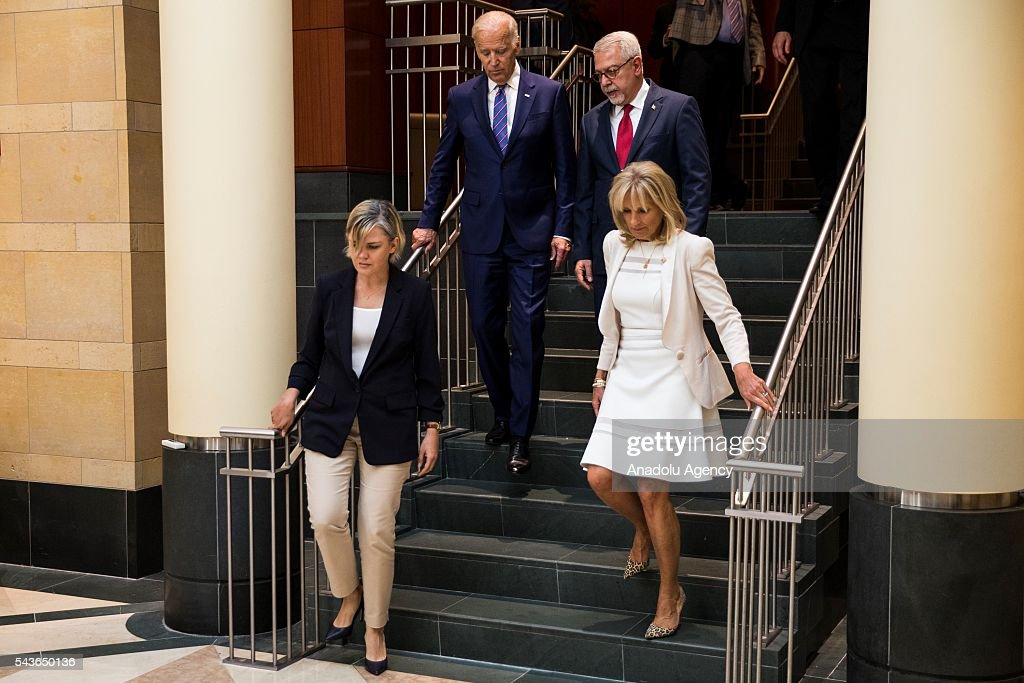 Vice President Joe Biden (center left) and Ambassador Serdar Klç (center right) enter the Turkish Embassy with their wives, Dr. Jill Biden (left) and Sinem Kilic (right), to leave their condolences for the victims of the Istanbul Airport bombing in a book at the Turkish Embassy in Washington, USA on June 29, 2016.