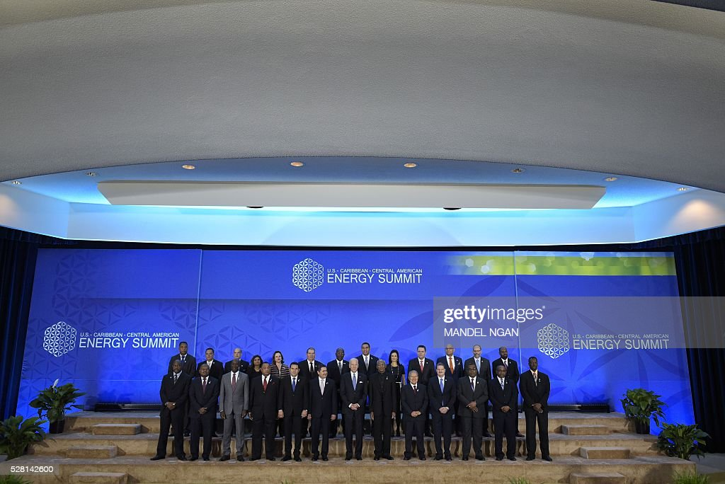 US Vice President Joe Biden and Caribbean heads of delegations pose for a group photo during the US, Caribbean, Central American Energy Summit in the Dean Acheson Auditorium of the State Department in Washington, DC on May 4, 2016. / AFP / MANDEL