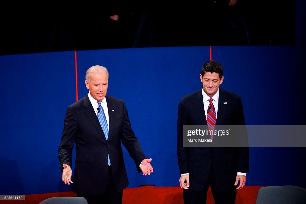 Vice President Joe Biden and Congressman Paul Ryan turn towards the audience after greeting one another before participating in the Vice Presidential...