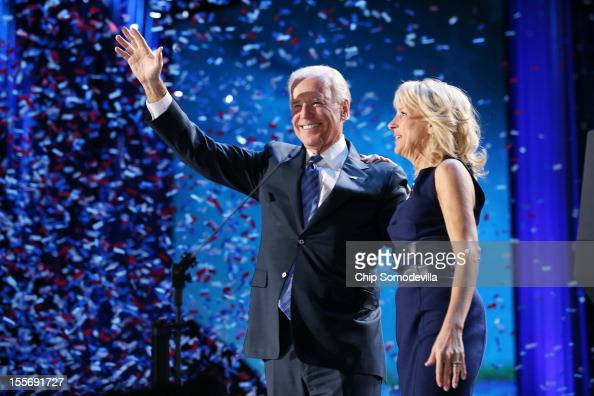 S Vice President Joe Biden and Dr Jill Biden stand on stage after the victory speech by US President Barack Obama on election night at McCormick...