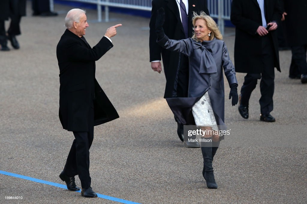 U.S. Vice President Joe Biden and Dr. <a gi-track='captionPersonalityLinkClicked' href=/galleries/search?phrase=Jill+Biden&family=editorial&specificpeople=997040 ng-click='$event.stopPropagation()'>Jill Biden</a> walk the route as the presidential inaugural parade winds through the nation's capital January 21, 2013 in Washington, DC. Barack Obama was re-elected for a second term as President of the United States.
