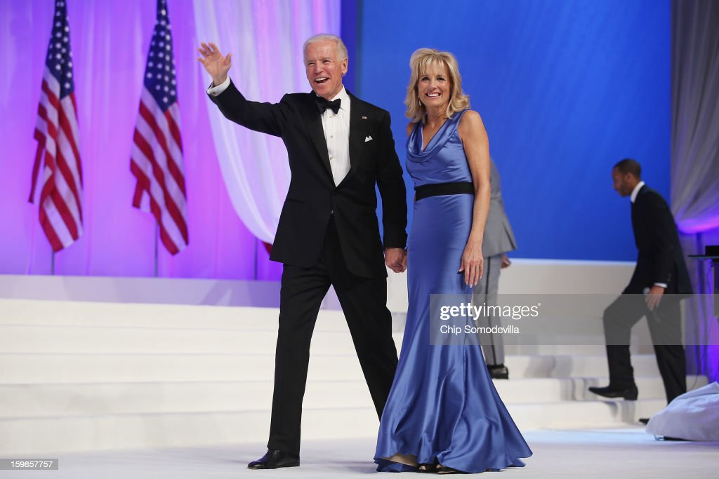 U.S. Vice President Joe Biden and Dr. <a gi-track='captionPersonalityLinkClicked' href=/galleries/search?phrase=Jill+Biden&family=editorial&specificpeople=997040 ng-click='$event.stopPropagation()'>Jill Biden</a> wave goodbye after dancing during the Comander-in-Chief's Inaugural Ball at the Walter Washington Convention Center January 21, 2013 in Washington, DC. Biden and President Barack Obama each took their oath of office earlier in the day.