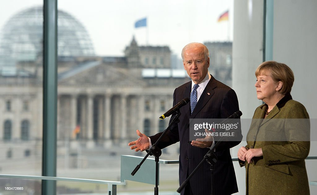 US Vice President Joe Biden and German Chancellor Angela Merkel (R) address journalists at the chancellery in Berlin on February 1, 2013. Biden is in Germany for talks with the German chancellor ahead of the Munich Security Conference. World leaders, ministers and top military brass attend three days of talks at the Munich Security Conference amid a US warning to Iran over stalled nuclear talks. AFP PHOTO / JOHANNES EISELE
