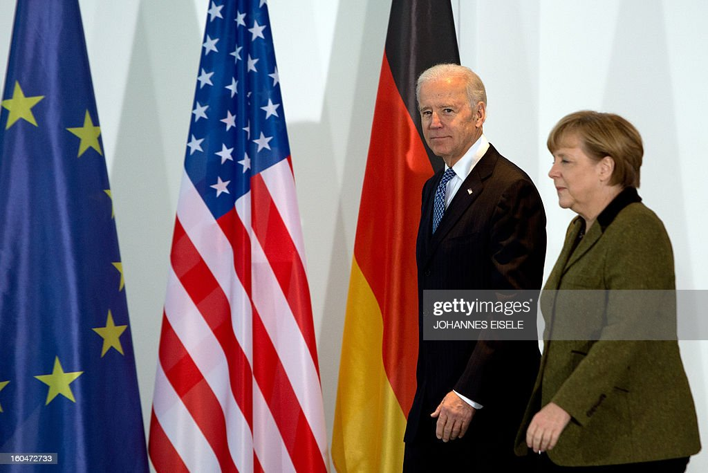 US Vice President Joe Biden and German Chancellor Angela Merkel (R) arrive to address journalists at the chancellery in Berlin on February 1, 2013. Biden is in Germany for talks with the German chancellor ahead of the Munich Security Conference. World leaders, ministers and top military brass attend three days of talks at the Munich Security Conference amid a US warning to Iran over stalled nuclear talks.