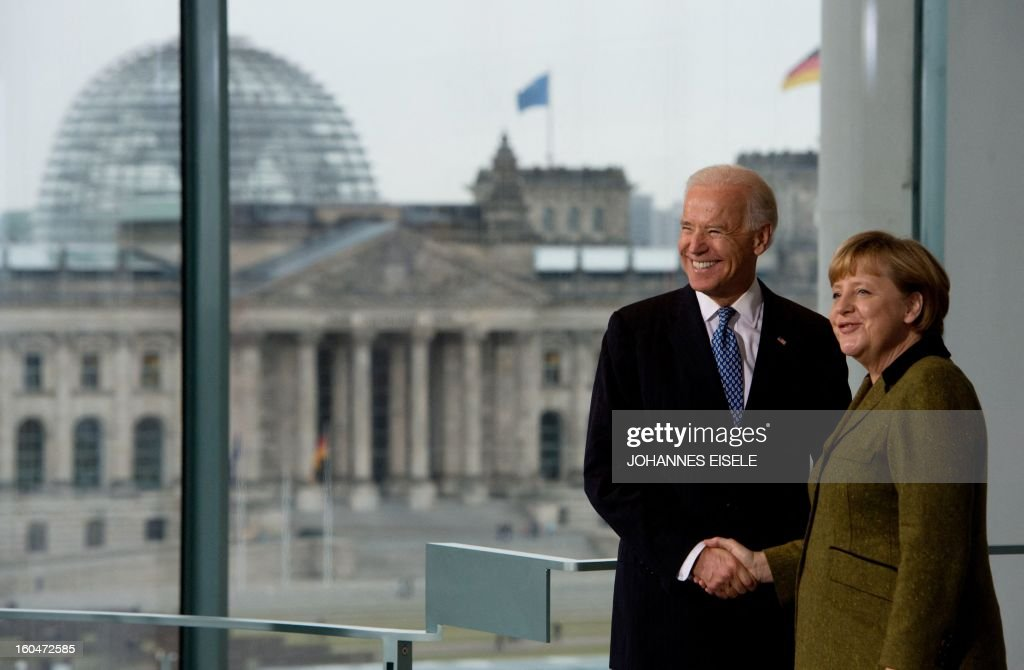 US Vice President Joe Biden and German Chancellor Angela Merkel (R) shake hands after addressing journalists at the chancellery in Berlin on February 1, 2013. Biden is in Germany for talks with the German chancellor ahead of the Munich Security Conference. World leaders, ministers and top military brass attend three days of talks at the Munich Security Conference amid a US warning to Iran over stalled nuclear talks.