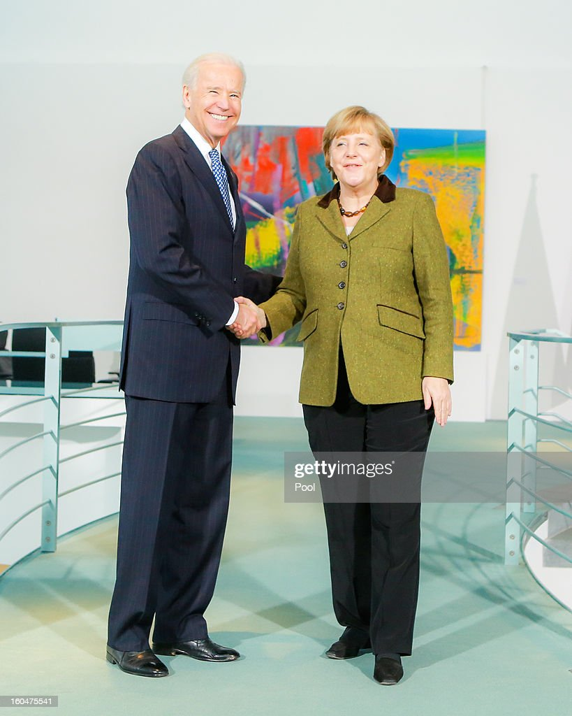 U.S. Vice President Joe Biden and German Chancellor <a gi-track='captionPersonalityLinkClicked' href=/galleries/search?phrase=Angela+Merkel&family=editorial&specificpeople=202161 ng-click='$event.stopPropagation()'>Angela Merkel</a> speak to the media prior to talks at the Chancellery on February 1, 2013 in Berlin, Germany. The two are meeting ahead of the Munich Security Conference, which takes place from February 1-3.