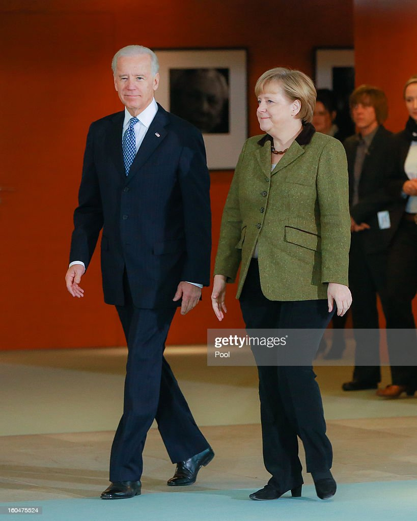 U.S. Vice President Joe Biden and German Chancellor <a gi-track='captionPersonalityLinkClicked' href=/galleries/search?phrase=Angela+Merkel&family=editorial&specificpeople=202161 ng-click='$event.stopPropagation()'>Angela Merkel</a> walk to speak to the media prior to talks at the Chancellery on February 1, 2013 in Berlin, Germany. The two are meeting ahead of the Munich Security Conference, which takes place from February 1-3.