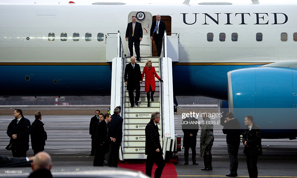 US Vice President Joe Biden (L) and his Jill Biden get out their plane upon arrival at the Tegel military airport in Berlin on February 1, 2013. Biden arrived in Germany to meet Chancellor Angela Merkel for talks ahead of the Munich Security Conference. EISELE