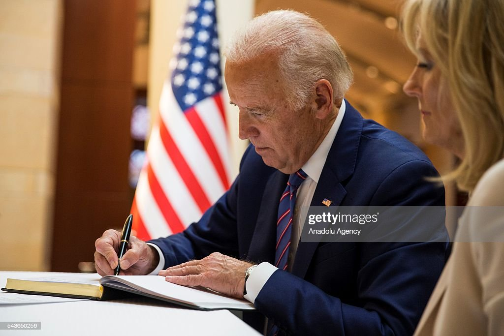 Vice President Joe Biden and his wife Dr. Jill Biden leave their condolences for the victims of the Istanbul Airport bombing in a book at the Turkish Embassy in Washington, USA on June 29, 2016.