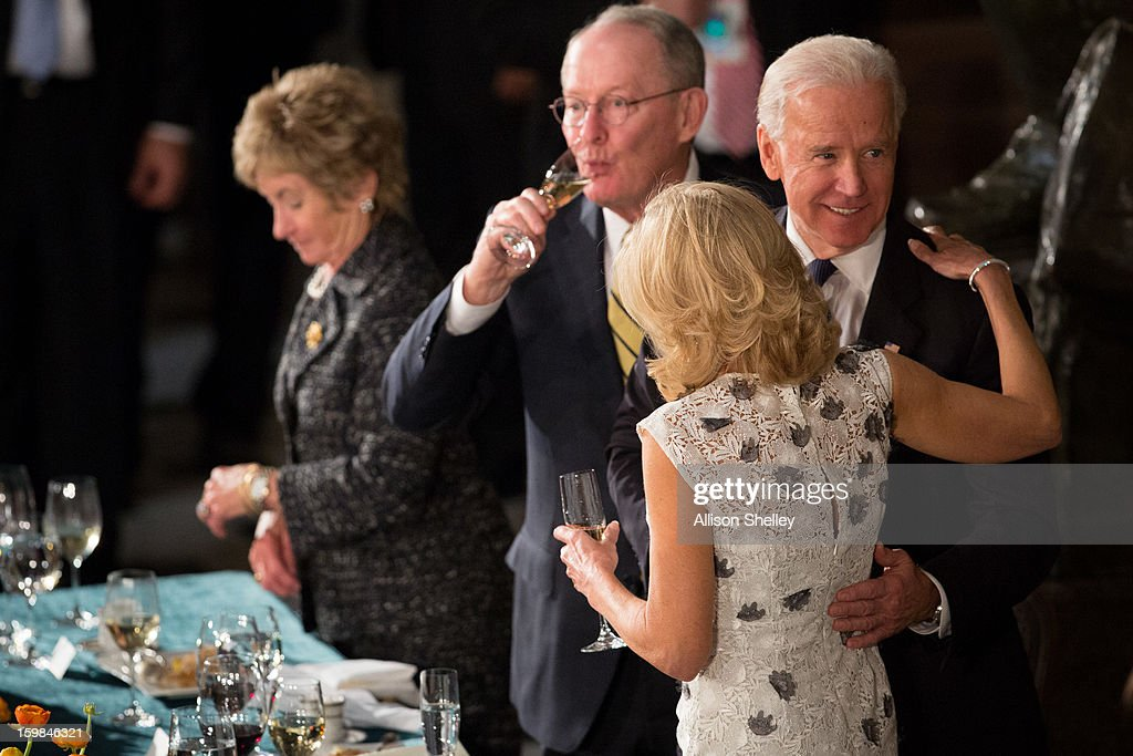 U.S. Vice President Joe Biden and his wife Dr. <a gi-track='captionPersonalityLinkClicked' href=/galleries/search?phrase=Jill+Biden&family=editorial&specificpeople=997040 ng-click='$event.stopPropagation()'>Jill Biden</a> share a moment at the Inaugural Luncheon in Statuary Hall on inauguration day at the U.S. Capitol building January 21, 2013 in Washington D.C. U.S. President Barack Obama was ceremonially sworn in for his second term today.