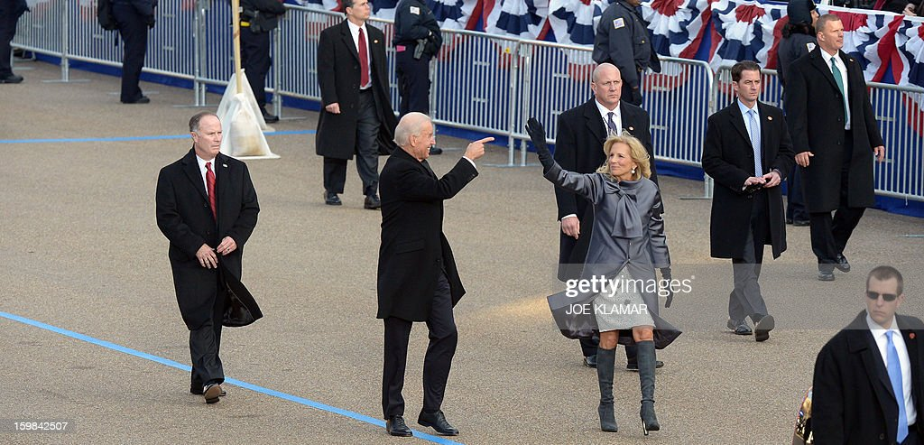 US Vice President Joe Biden(C) and his wife Dr. Jill Biden walk along Pennsylvania Avenue during the parade following Obama's second inauguration as the 44th US president on January 21, 2013 in Washington, DC.AFP PHOTO/JOE KLAMAR