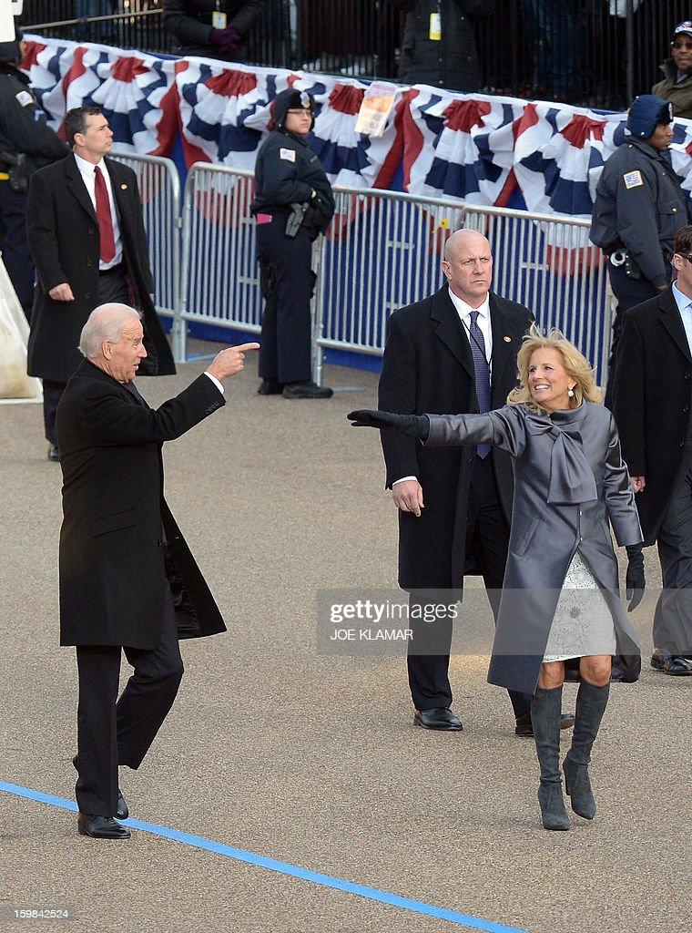 US Vice President Joe Biden and his wife Dr. Jill Biden walk along Pennsylvania Avenue during the parade following Obama's second inauguration as the 44th US president on January 21, 2013 in Washington, DC