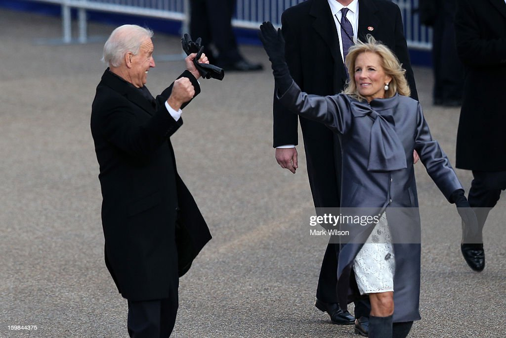 U.S. Vice President Joe Biden (L) and his wife Dr. Jill Biden walk the route as the presidential inaugural parade winds through the nation's capital January 21, 2013 in Washington, DC. Barack Obama was ceremonially sworn in for a second term as President of the United States.
