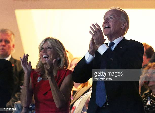 S Vice President Joe Biden and his wife Dr Jill Biden watch a video tribute to deceased former US Sen Edward Kennedy during day one of the Democratic...