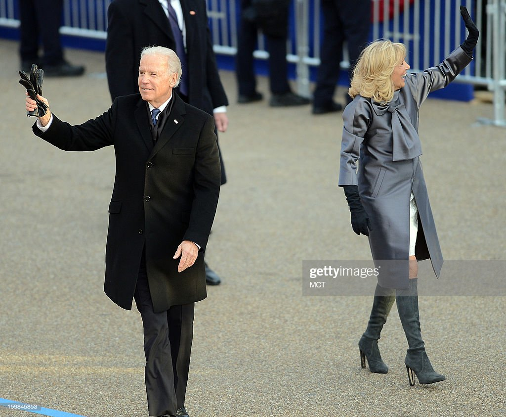 U.S. Vice President Joe Biden and his wife, Dr. Jill Biden, wave to supporters during the Inauguration Parade for the second term of U.S. President Barack Obama in Washington, D.C., Monday, January 21, 2013.
