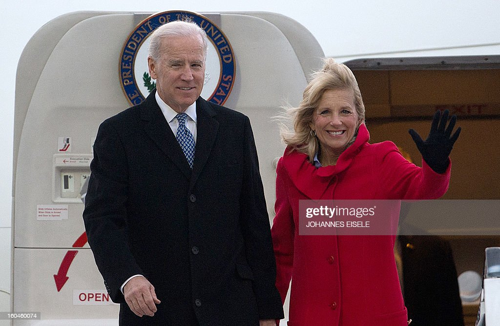 US Vice President Joe Biden (L) and his wife Jill Biden (R) wave upon arrival at the Tegel military airport in Berlin on February 1, 2013. Biden is to meet German Chancellor Angela Merkel for talks ahead of the Munich Security Conference. EISELE