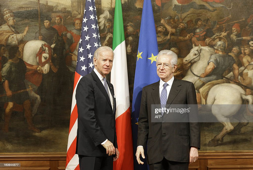 U.S. Vice President Joe Biden (L) and Italian Premier Mario Monti meet in Rome on March 18, 2013. Joe Biden will lead the US delegation to newly elected Pope Francis' inauguration mass in Rome.