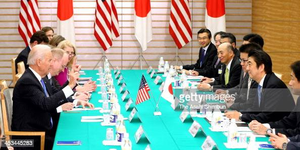US Vice President Joe Biden and Japanese Prime Minister Shinzo Abe talk during their meeting at Abe's official residence during his visit to Japan on...