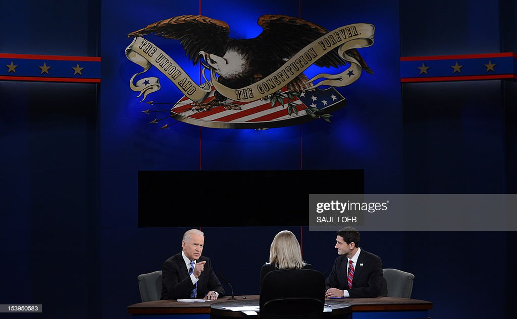US Vice President Joe Biden (L) and Republican vice presidential candidate Paul Ryan (R) participate in the vice presidential debate at the Norton Center at Centre College in Danville, Kentucky, October 10, 2012, moderated by Martha Raddatz (C) of ABC News. AFP PHOTO / Saul LOEB