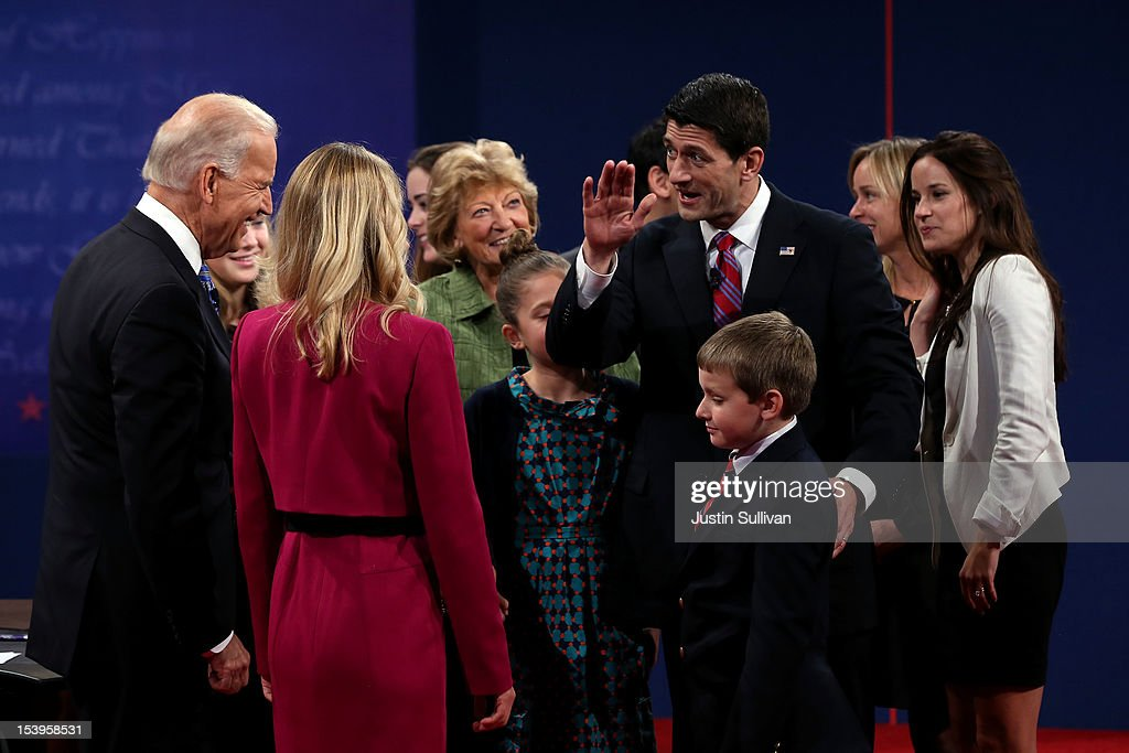 U.S. Vice President Joe Biden (L) and Republican vice presidential candidate U.S. Rep. Paul Ryan (R-WI) (R) meet with family after the vice presidential debate at Centre College October 11, 2012 in Danville, Kentucky. This is the second of four debates during the presidential election season and the only debate between the vice presidential candidates before the closely-contested election November 6.