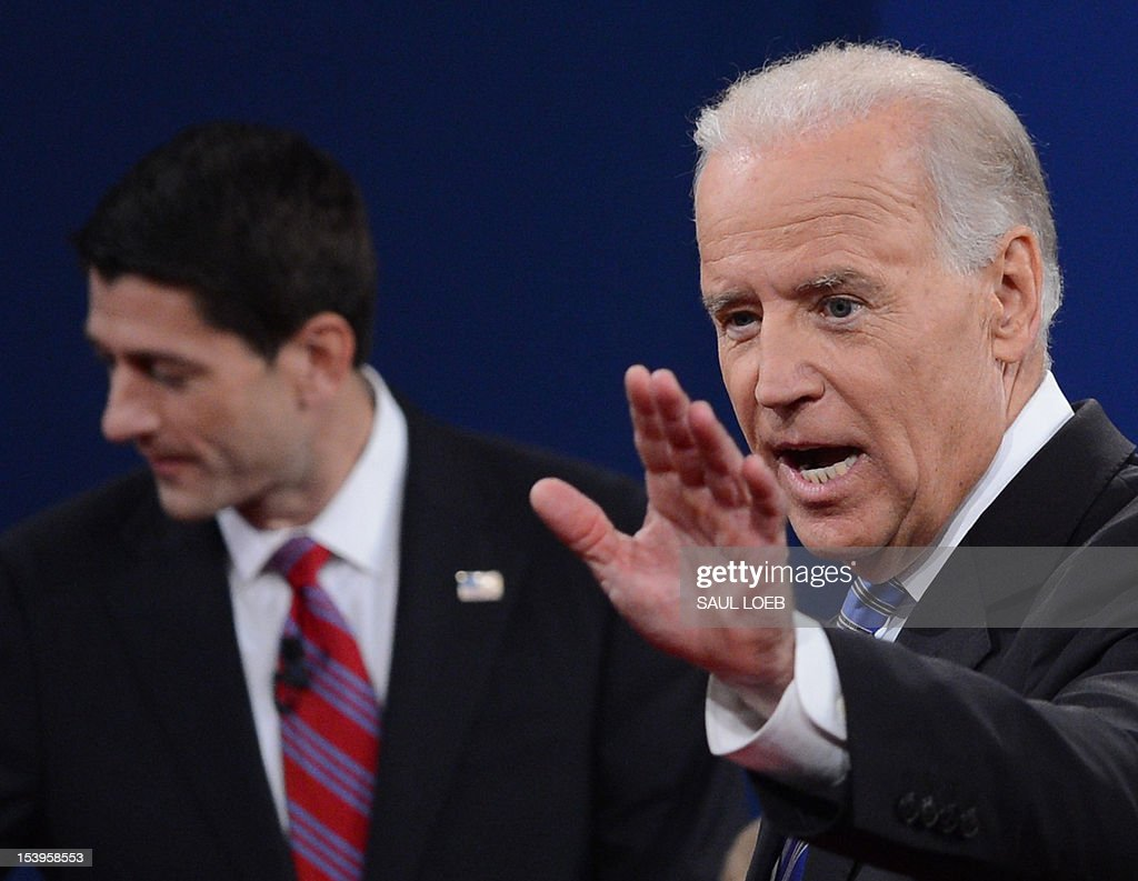 US Vice President Joe Biden (R) and Republican vice presidential candidate Paul Ryan (L) depart the stage following their debate at the Norton Center at Centre College in Danville, Kentucky, October 10, 2012, moderated by Martha Raddatz of ABC News. AFP PHOTO / Saul LOEB AFP PHOTO / Saul LOEB