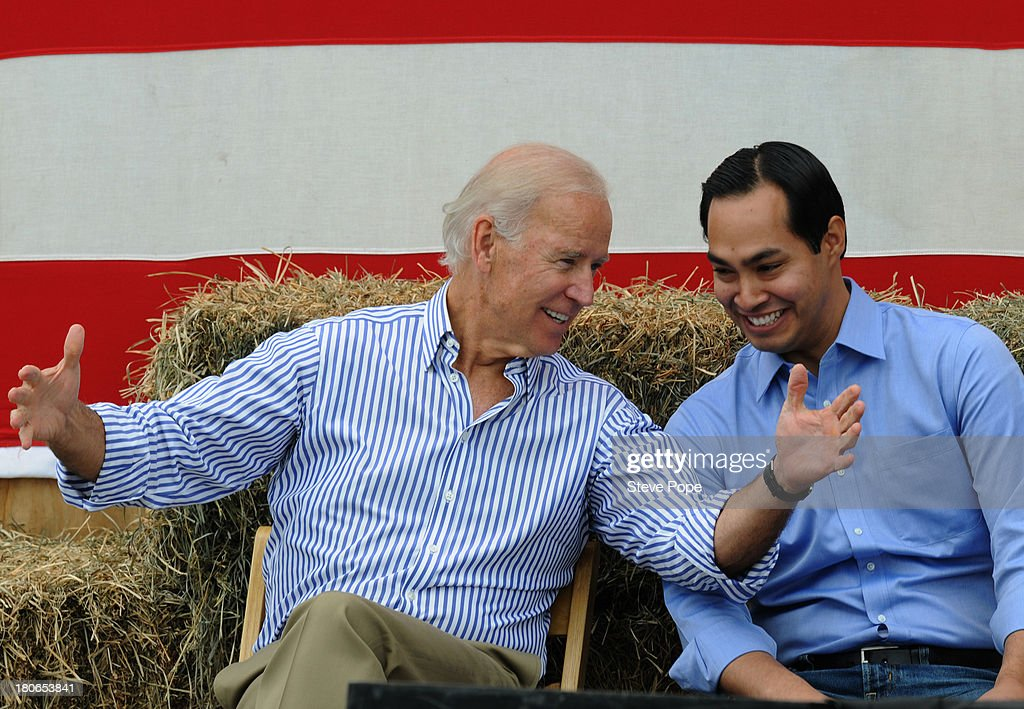 U.S. Vice President Joe Biden (R) and San Antonio Mayor Julian Castro share a moment onstage at the 36th Annual Harkin Steak Fry on September 15, 2013 in Indianola, Iowa. Sen. Harkin's Democratic fundraiser is one of the largest in Iowa each year.