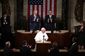 Vice President Joe Biden and Speaker of the House John Boehner applaud Pope Francis after his speech in a joint meeting of the US Congress in the...