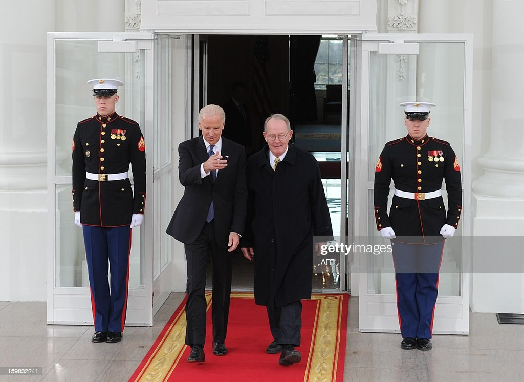 US Vice President Joe Biden (L) and US Republican Senator from Tennessee Lamar Alexander, vice-chairman of the Joint Congressional Committee on Inaugural Ceremonies, leave the White House on January 21, 2013 for the US Capitol in Washington, DC, for the ceremonial swearing in of the president and vice president to a second term in office. AFP PHOTO/Rod LAMKEY, JR.