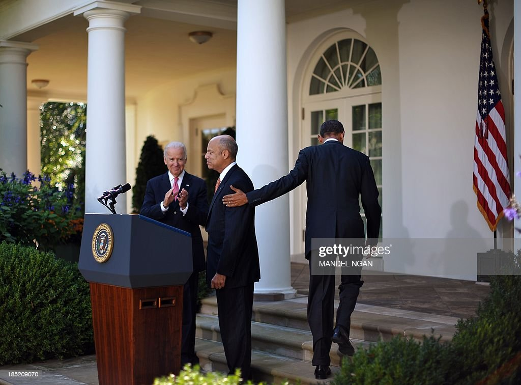 US Vice President Joe Biden (L) applauds as US President <a gi-track='captionPersonalityLinkClicked' href=/galleries/search?phrase=Barack+Obama&family=editorial&specificpeople=203260 ng-click='$event.stopPropagation()'>Barack Obama</a> (R) puts his hand on the shoulder of Jeh Johnson after a press conference in the Rose Garden of the White House on October 18, 2013 in Washington, DC. Obama announced Johnson as his choice to be the next Homeland Security secretary. AFP PHOTO/Mandel NGAN