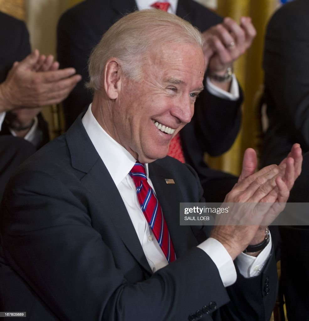 US Vice President Joe Biden applauds during an event highlighting Joining Forces hiring initiative for military veterans and spouses in civilian jobs in the East Room of the White House in Washington, DC, on April 30, 2013. Since President Obama challenged American businesses to hire US military veterans and spouses in August 2011, they have hired or trained 290,000 military veterans and spouses and now pledge to hire or train an additional 435,000 veterans and military spouses by 2018. AFP PHOTO / Saul LOEB