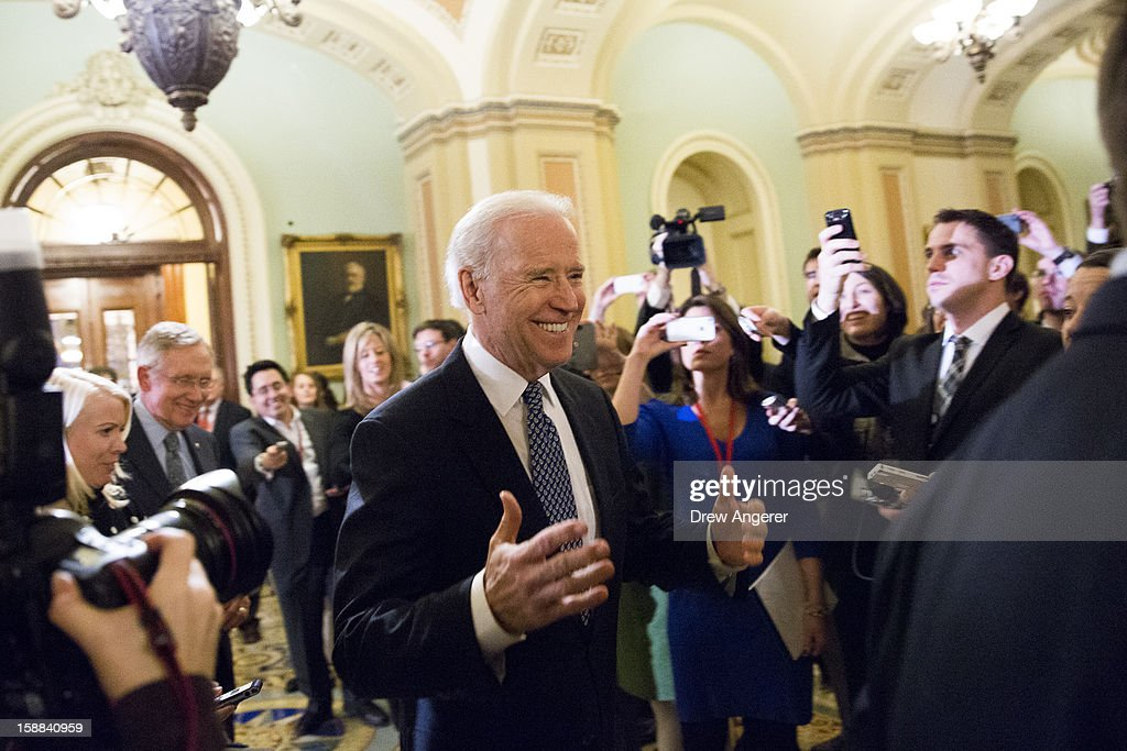 U.S. Vice President Joe Biden arrives for a closed-door meeting with Senate Democrats to urge them to support a tentative tax agreement with Senate Minority Leader Mitch McConnell (R-KY) on Capitol Hill on December 31, 2012, in Washington DC. The House and Senate are both still in session on New Year's Eve to try to deal with the looming fiscal cliff issue.