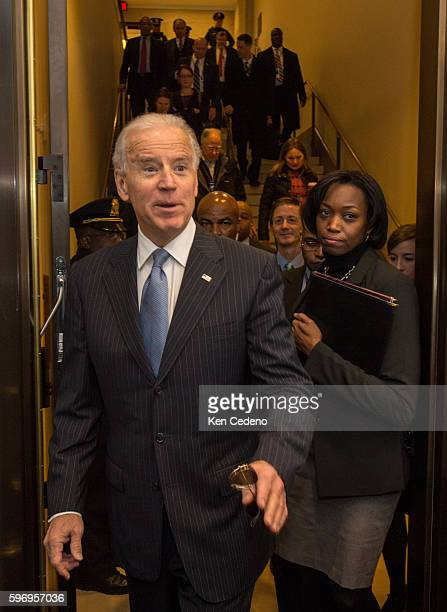 Vice President Joe Biden arrives for a House Democratic Caucus meeting for an unusual New Year's Day session to discuss legislation that will curb...