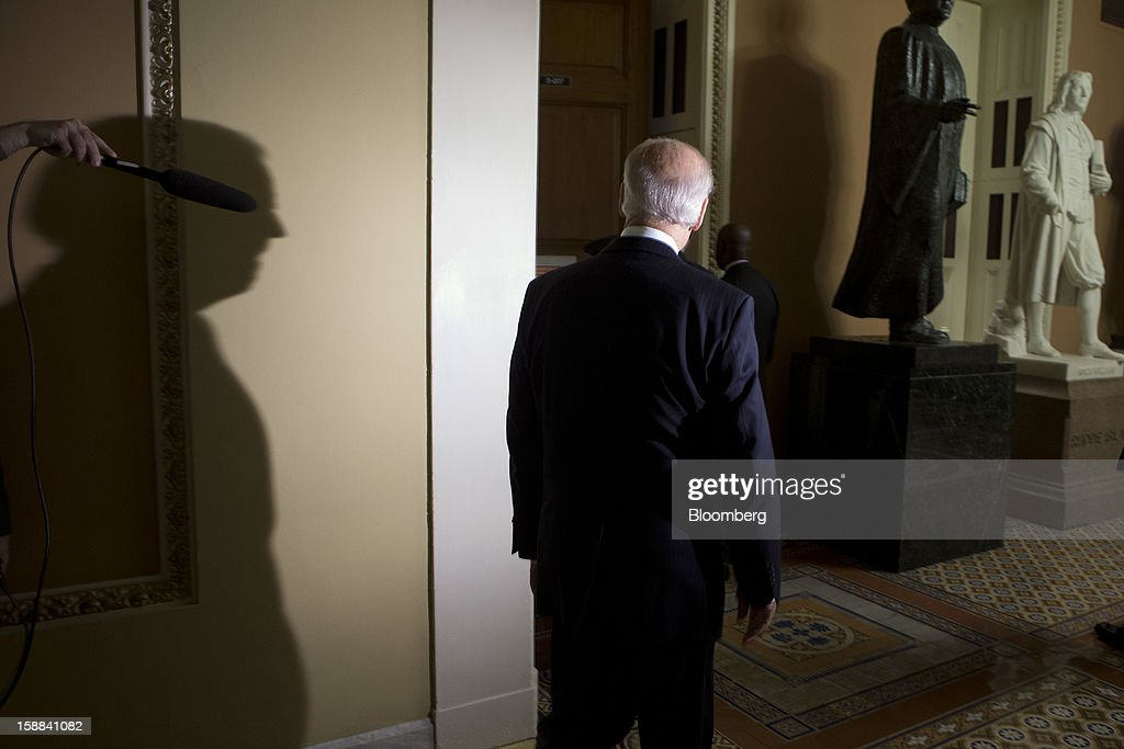 U.S. Vice President Joe Biden arrives to a Democratic caucus meeting at the U.S. Capitol in Washington, D.C., U.S., on Monday, Dec. 31, 2012. Biden arrived at the Capitol to present a budget deal to wavering Democrats, in advance of a possible vote by 10:30 p.m. tonight, with tax increases for almost every U.S. worker set to start tomorrow. Photographer: Andrew Harrer/Bloomberg via Getty Images