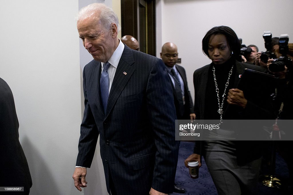 U.S. Vice President Joe Biden arrives to a House Democratic caucus meeting at the U.S. Capitol in Washington, D.C., U.S., on Tuesday, Jan. 1, 2013. The U.S. Senate passed a bipartisan budget deal two hours after income tax cuts expired, reaching an after-deadline agreement to undo the potential economic harm of $600 billion in tax increases and spending cuts. Photographer: Andrew Harrer/Bloomberg via Getty Images