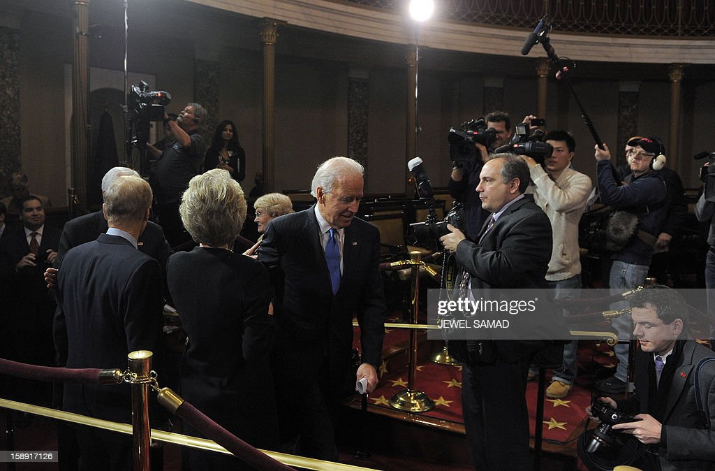 US Vice President Joe Biden arrives to participate in a reenacted swearing-in for US Senators in the Old Senate Chamber at the U.S. Capitol January 3, 2013 in Washington, DC. The 113th US Congress, featuring dozens of new faces in the House and Senate, convened Thursday fresh from the year-end 'fiscal cliff' fiasco, as lawmakers cast a wary eye towards the tough budget battles ahead. AFP PHOTO/Jewel Samad