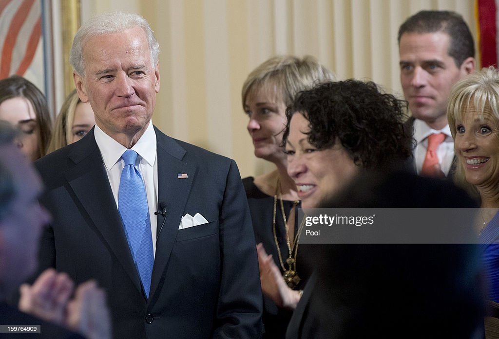 U.S. Vice President Joe Biden (4th L) arrives to take the oath to take the oath of office from U.S. Supreme Court Justice Sonia Sotomayor (3rd R) as his wife Dr. Jill Biden (L) looks on during the official swearing-in ceremony at the Naval Observatory on January 20, 2013 in Washington, DC. Biden and U.S. President Barack Obama will be officially sworn in a day before the ceremonial inaugural swearing-in.