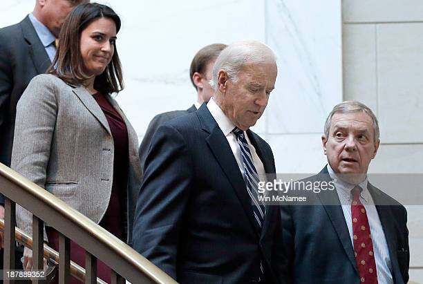 S Vice President Joe Biden arrives with US Sen Richard Durbin for a briefing with Senate Democratic leadership on negotiations with Iran November 13...