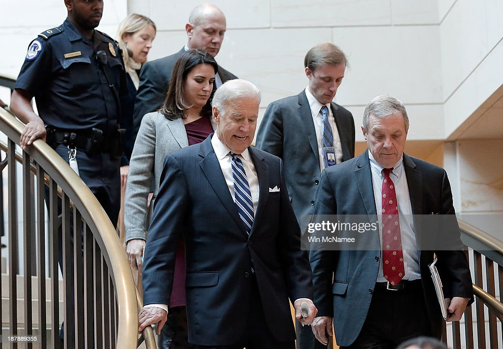 U.S. Vice President Joe Biden (3rd R) arrives with U.S. Sen. Richard Durbin (D-IL) (R) for a briefing with Senate Democratic leadership on negotiations with Iran November 13, 2013 in Washington, DC. Kerry was scheduled to brief members of the Senate on Iran and the status of the P5+1 negotiations.